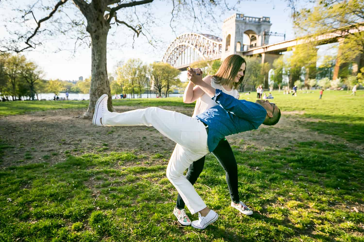 Woman dipping man while dancing during an Astoria Park engagement shoot