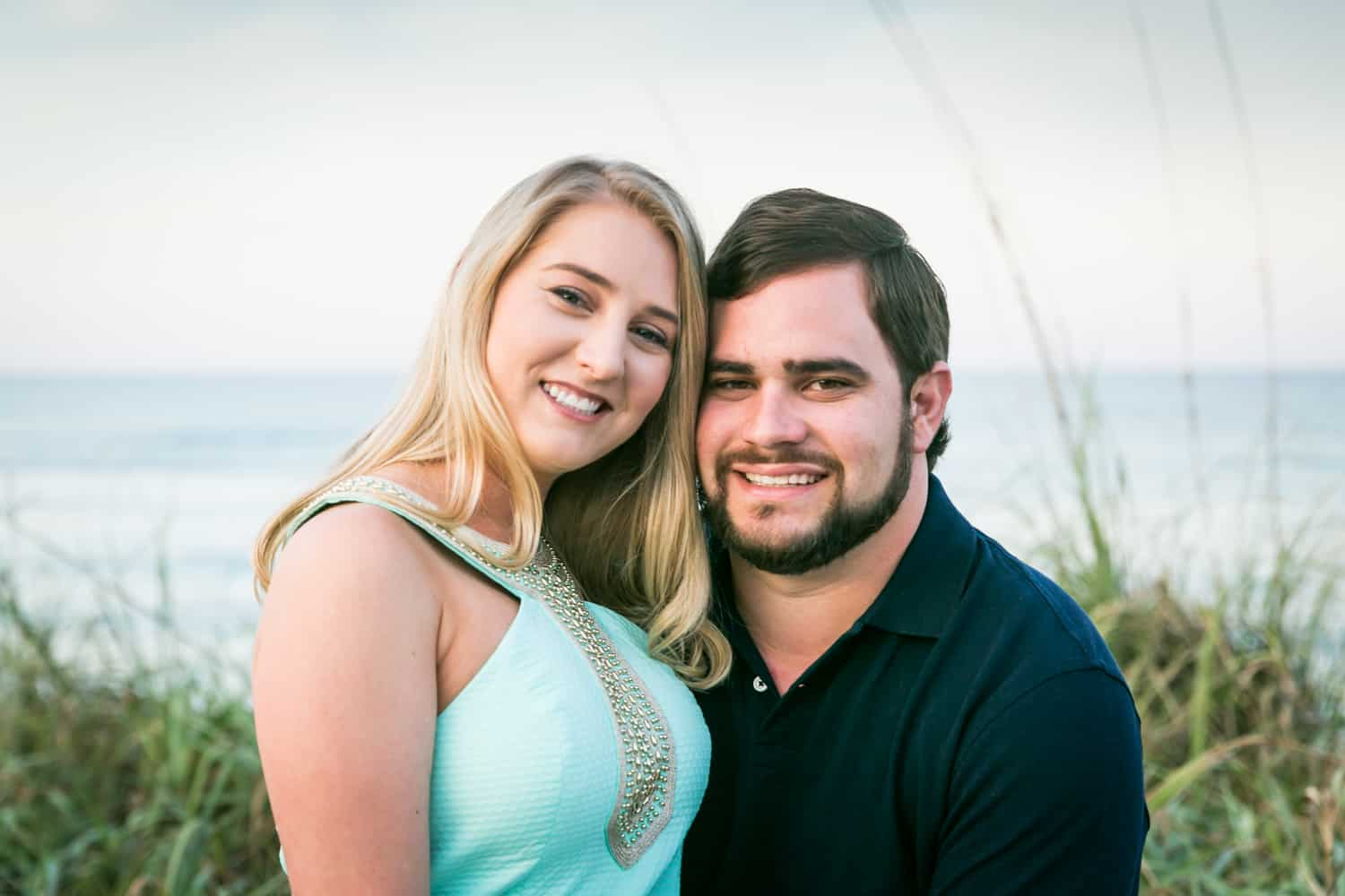 Couple in front of ocean during a Coral Cove Park engagement shoot