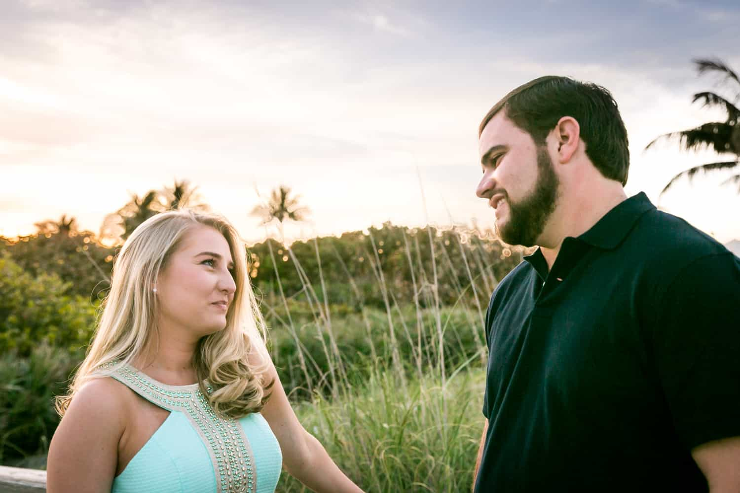 Couple looking at each other during a Coral Cove Park engagement shoot