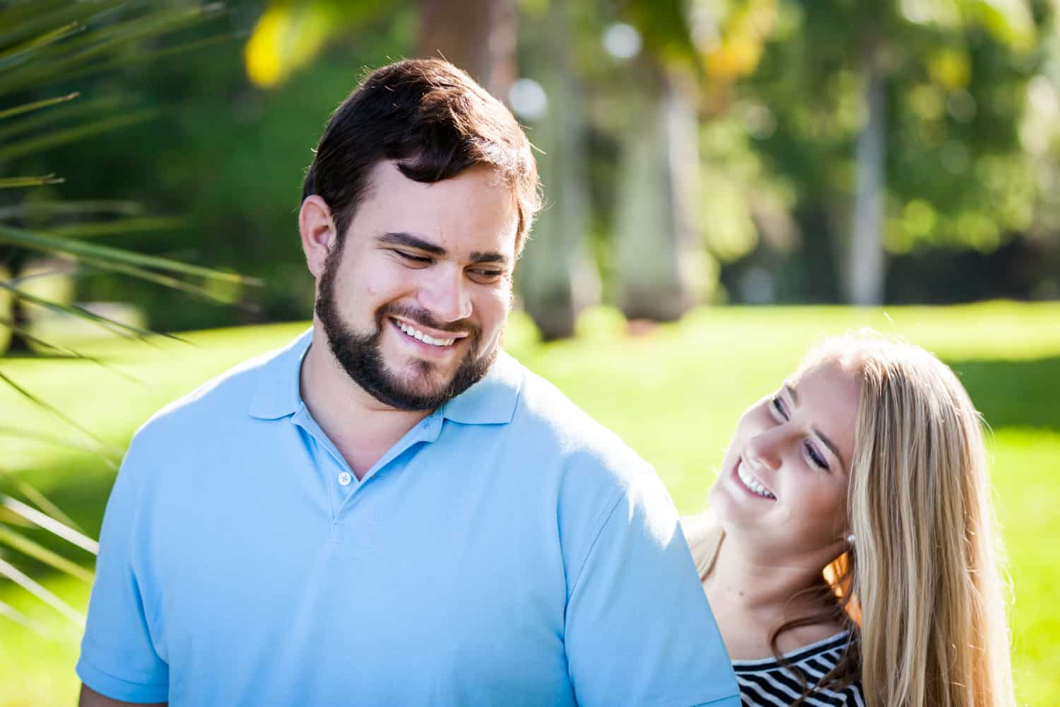 Couple smiling in backyard