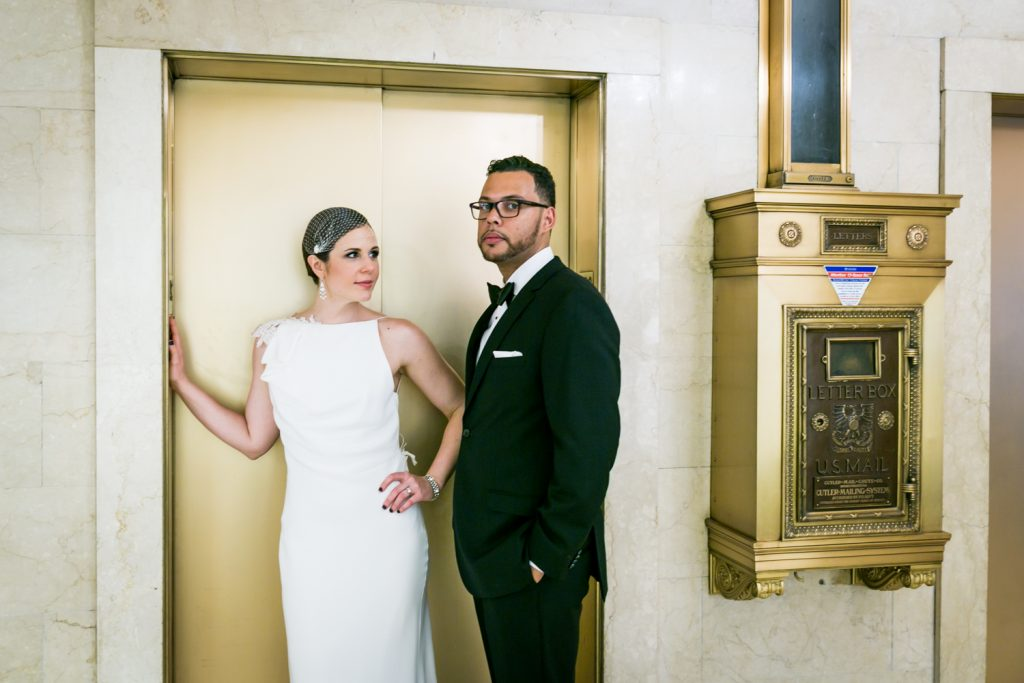 Bride looking at groom outside of elevator in Roosevelt Hotel wedding photo