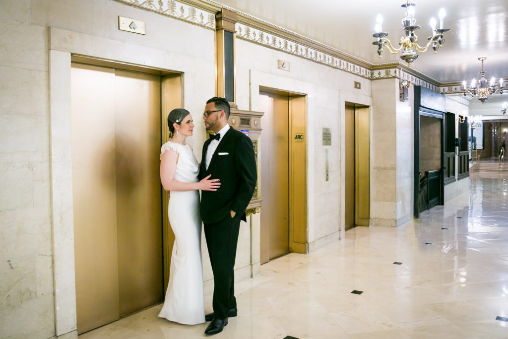 Bride and groom looking at each other in front of elevator in Roosevelt Hotel wedding photo