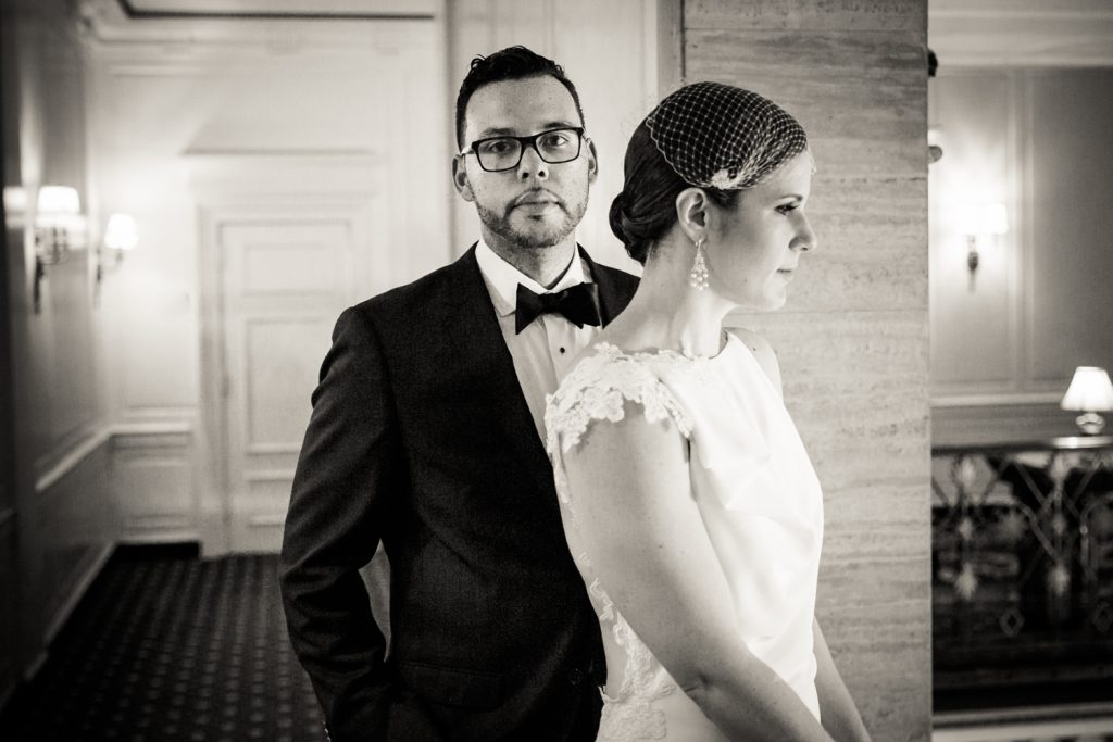 Black and white portrait of bride and groom in hallway in Roosevelt Hotel wedding photo