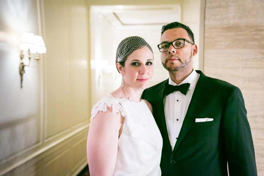 Portrait of bride and groom in hotel hallway in Roosevelt Hotel wedding photo