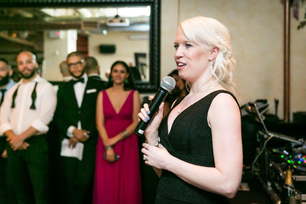 Bridesmaid making a speech at wedding reception