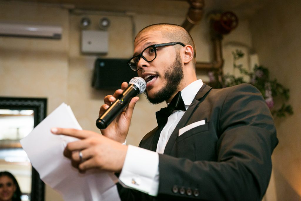 Best man making speech at wedding reception