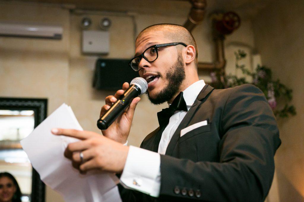 Best man making speech at wedding reception