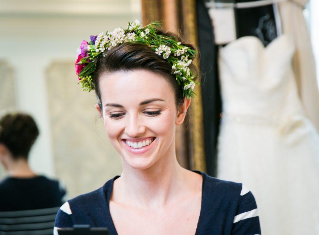 Bride with flower crown getting ready at a Snug Harbor wedding