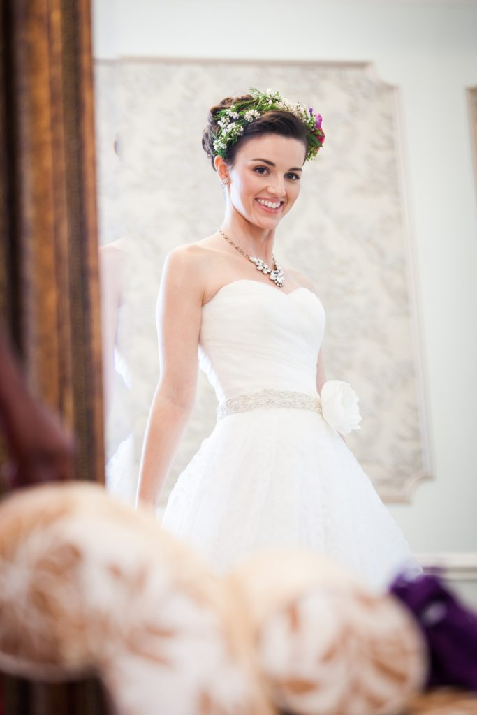 Bride smiling at herself in the mirror at a Snug Harbor wedding
