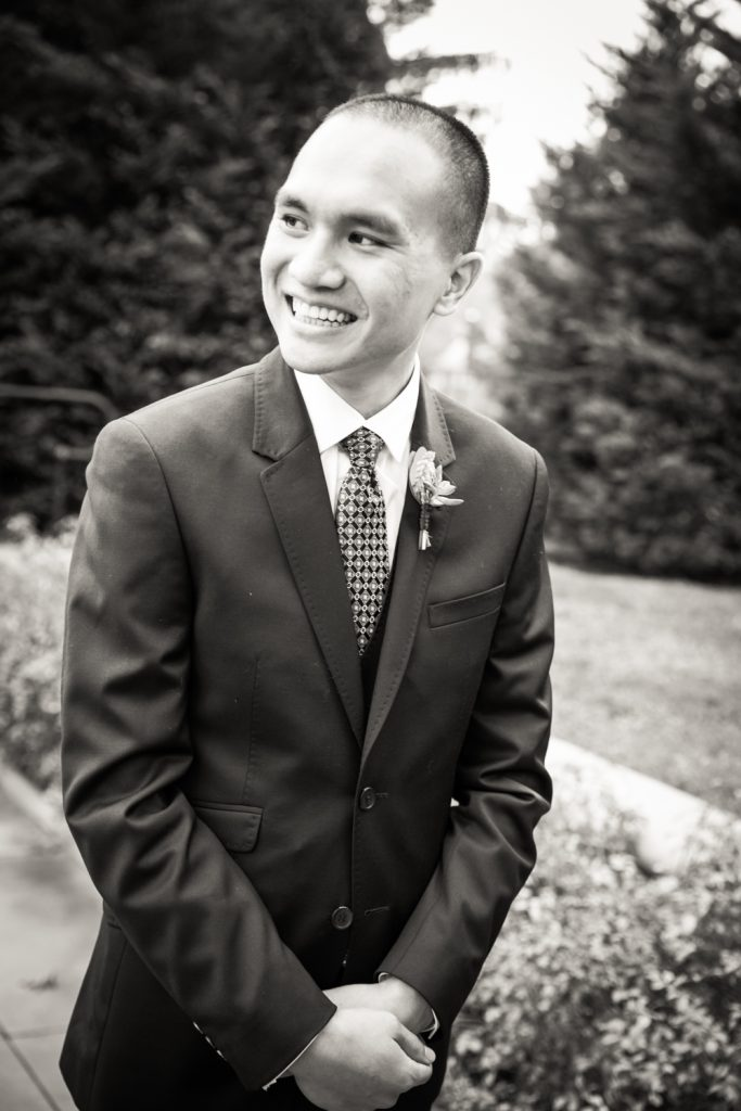 Black and white photo of groom waiting for bride at a Snug Harbor wedding