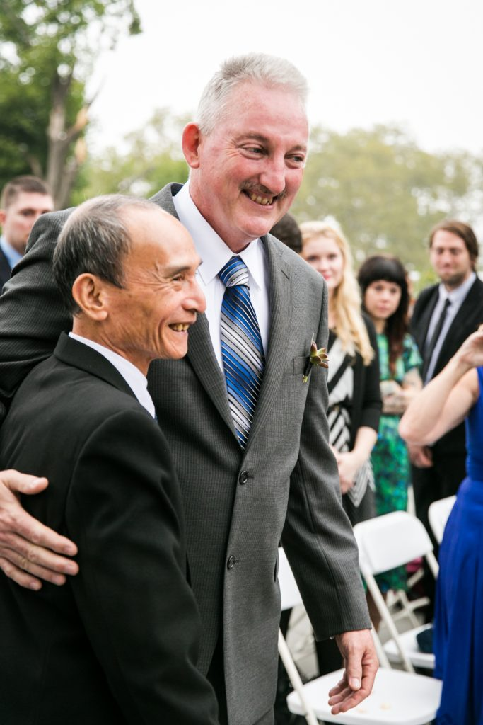 Father of bride and father of groom hugging at a Snug Harbor wedding