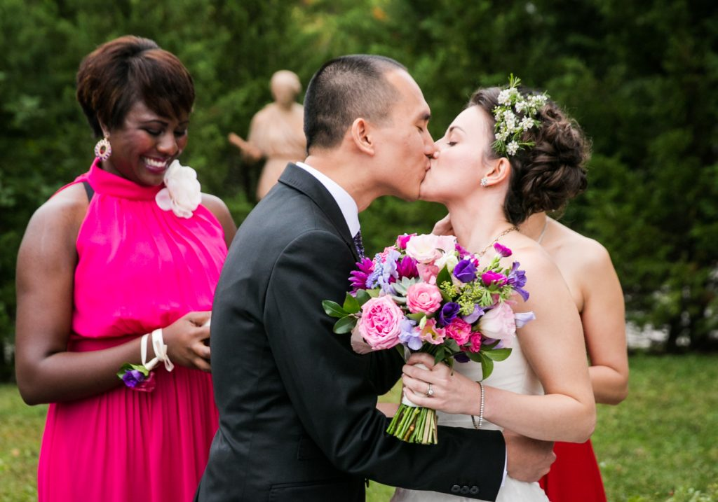 Bride and groom kissing after ceremony at a Snug Harbor wedding