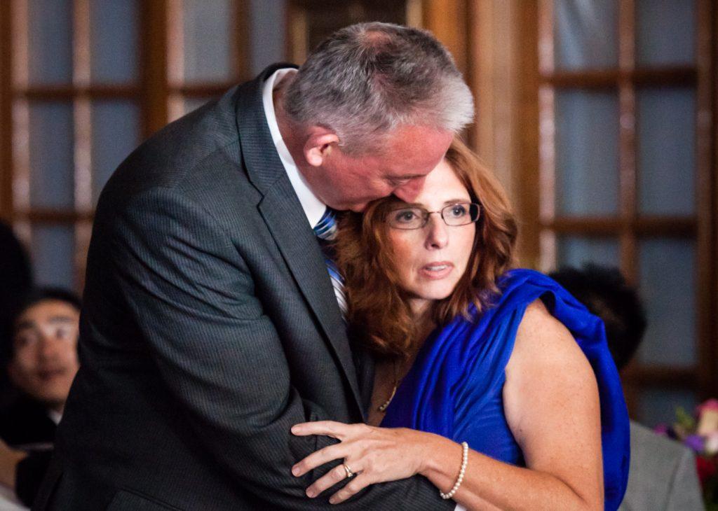 Guests hugging at a Snug Harbor wedding