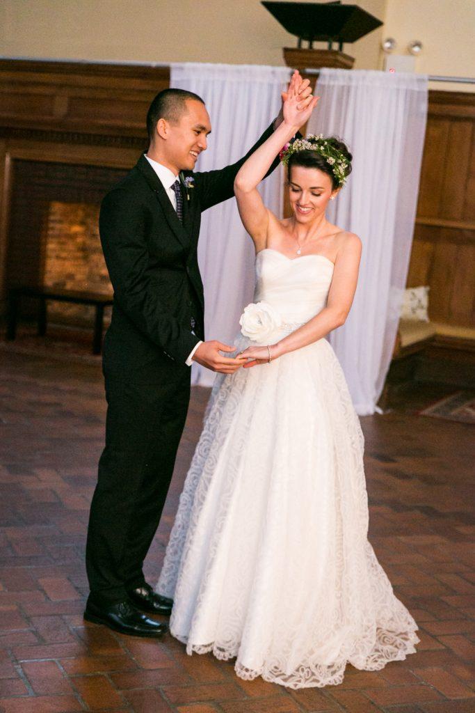 Groom twirling bride during first dance at a Snug Harbor wedding