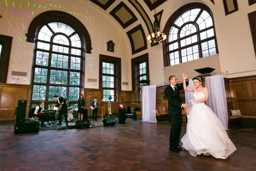 Bride and groom dancing in front of live band in Great Hall Ballroom