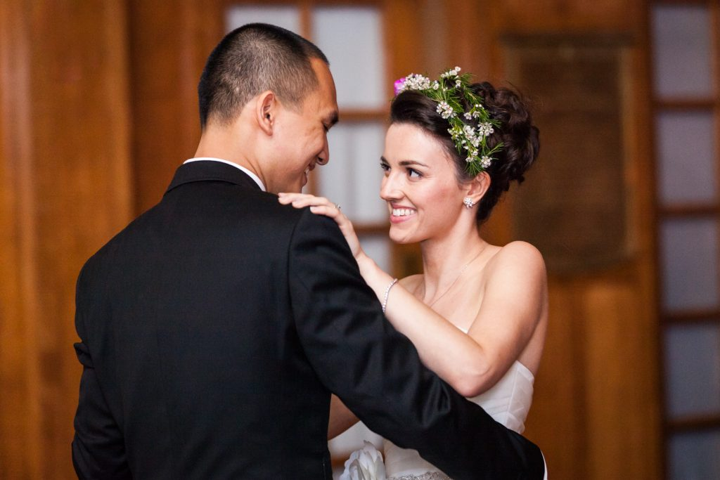 Bride and groom looking at each other during first dance at a Snug Harbor wedding