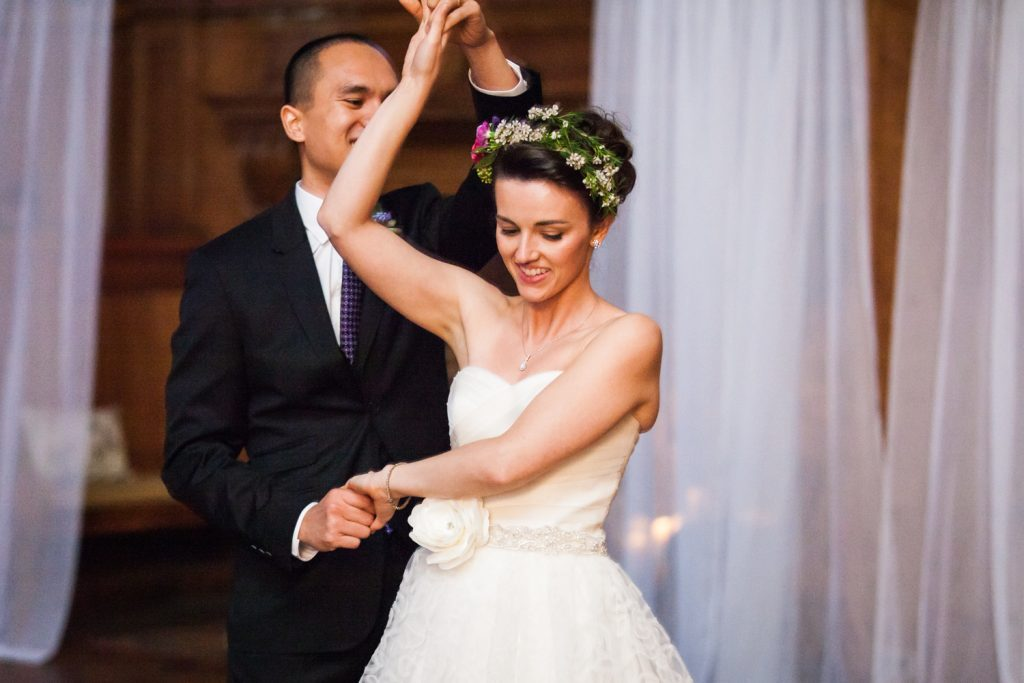 Groom twirling bride for article on how to get perfect first dance photos