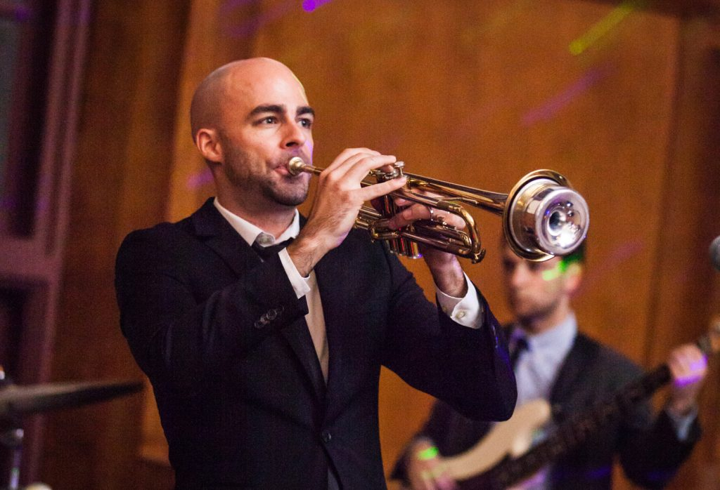 Silver Arrow Band member playing the trumpet at a Snug Harbor wedding