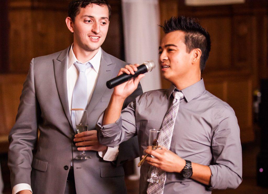 Two men making a speech at a Snug Harbor wedding