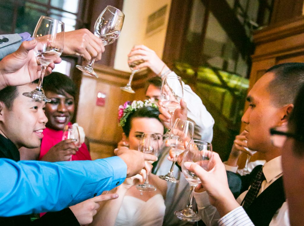 Guests cheering with glasses at a Snug Harbor wedding