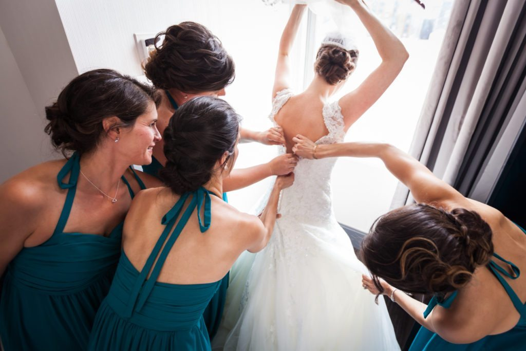 Bride getting ready for a Columbus Citizens Foundation wedding by NYC wedding photojournalist, Kelly Williams
