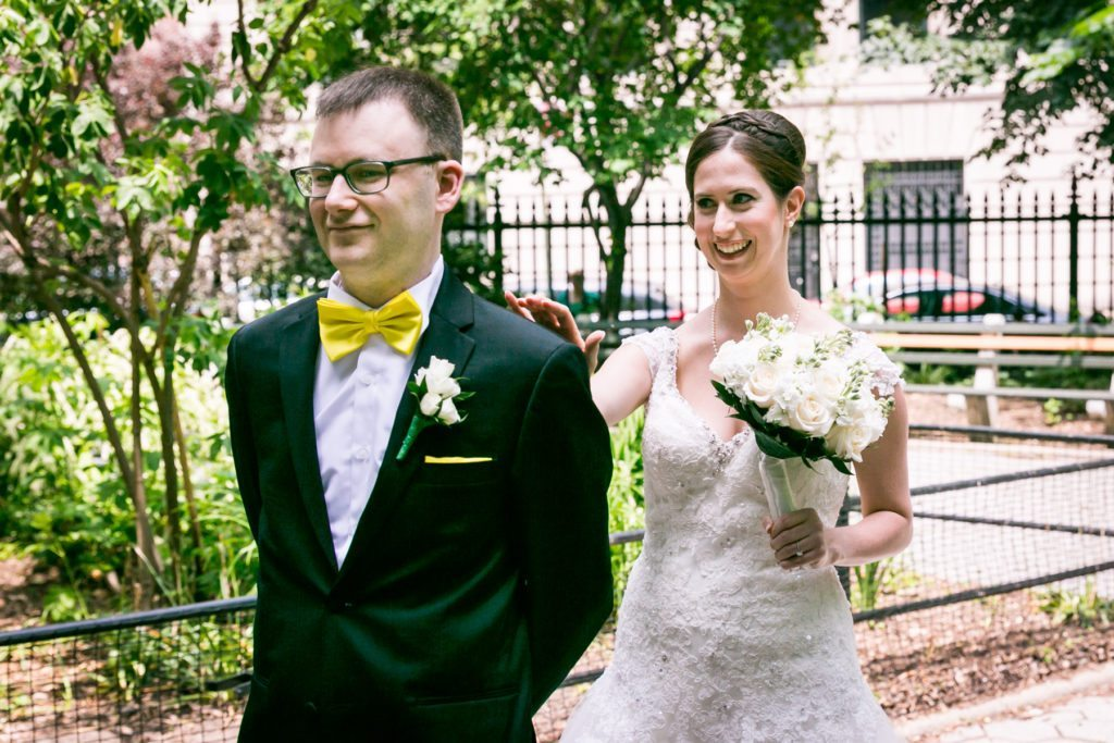 First look in Stuyvesant Square before a Columbus Citizens Foundation wedding by NYC wedding photojournalist, Kelly Williams