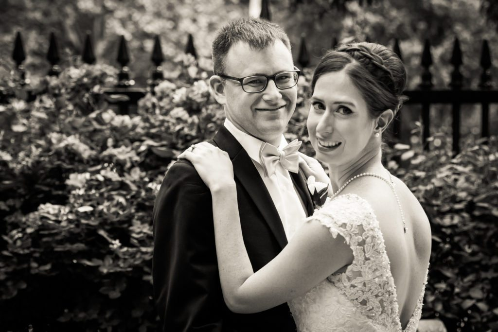 Bride and groom portrait in Stuyvesant Square before a Columbus Citizens Foundation wedding by NYC wedding photojournalist, Kelly Williams