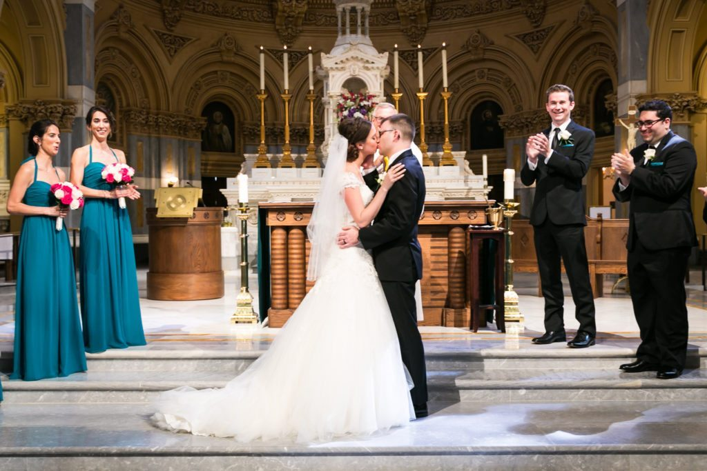 Ceremony at the Church of St. Francis Xavier before a Columbus Citizens Foundation wedding by NYC wedding photojournalist, Kelly Williams