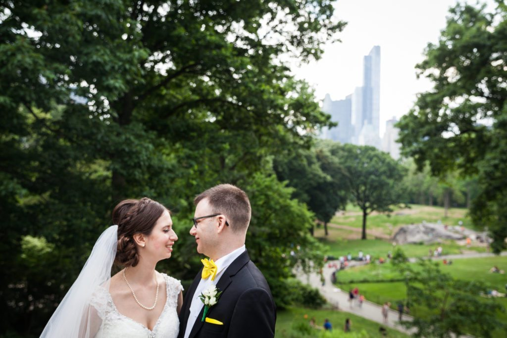 Bride and groom portrait in Central Park before a Columbus Citizens Foundation wedding by NYC wedding photojournalist, Kelly Williams