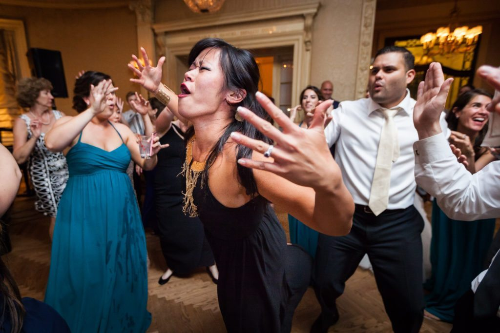 Guest dancing at a Columbus Citizens Foundation wedding by NYC wedding photojournalist, Kelly Williams