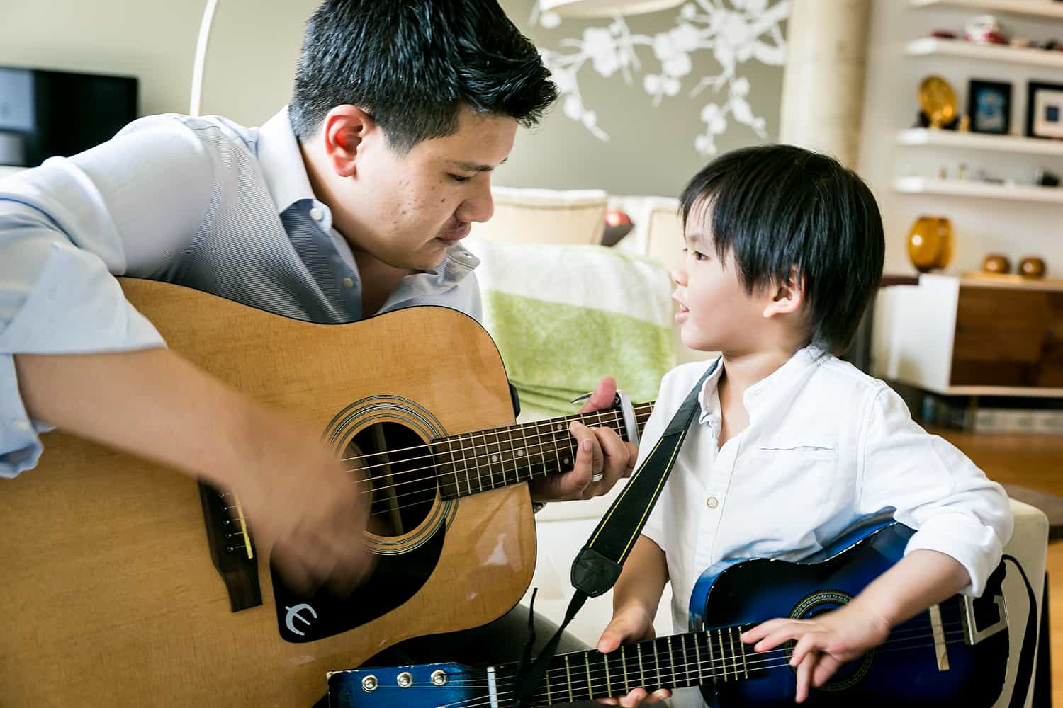 Chelsea family portrait of father and little boy playing guitar