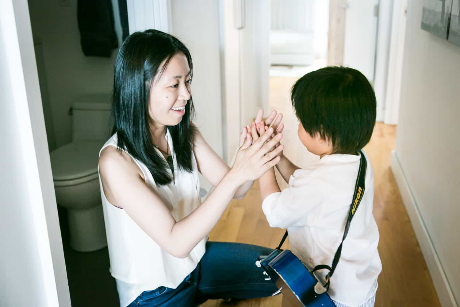 Mother clapping hands with little boy