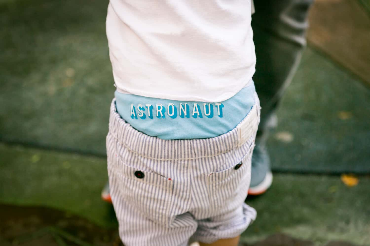 Close up on little boy wearing 'astronaut' underwear
