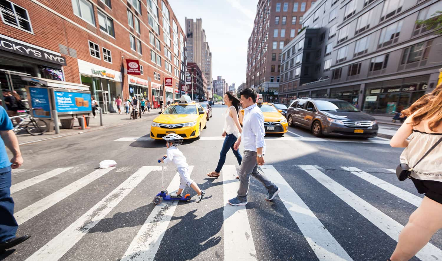 Chelsea family portrait of parents and little boy in Manhattan crosswalk