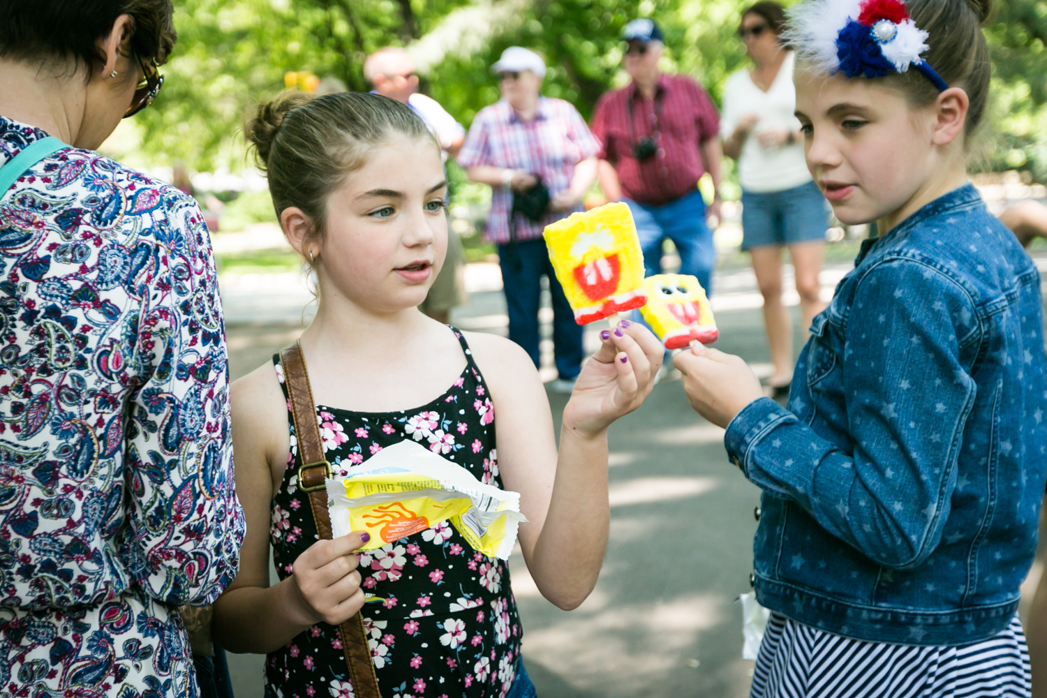 Two little girls in Central Park holding Spongebob ice creams