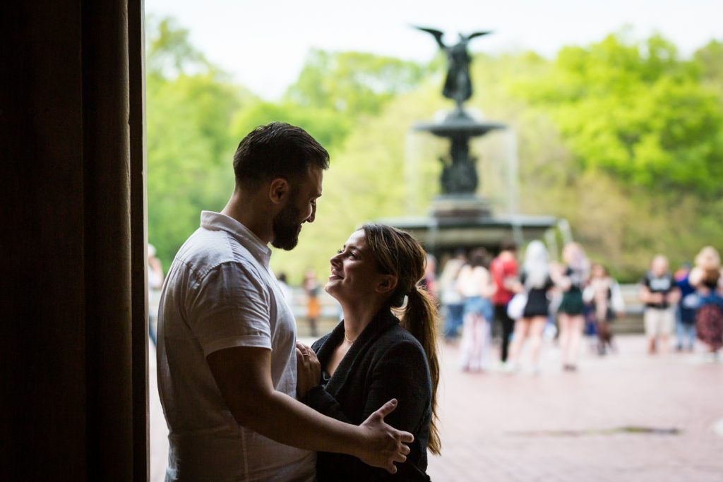 Couple looking at each other with Bethesda Fountain in the background