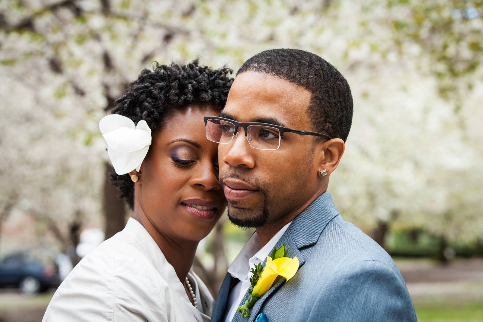 Portrait of bride and groom with cherry blossoms after first look