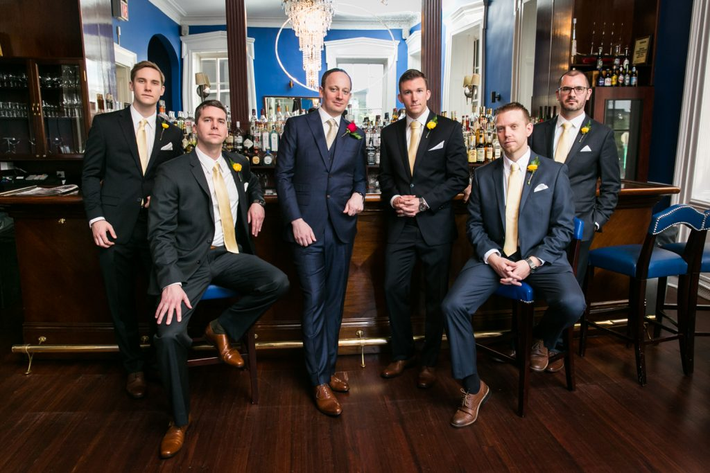 Portrait of groomsmen in the India House bar for an article on NYC rainy day photo tips