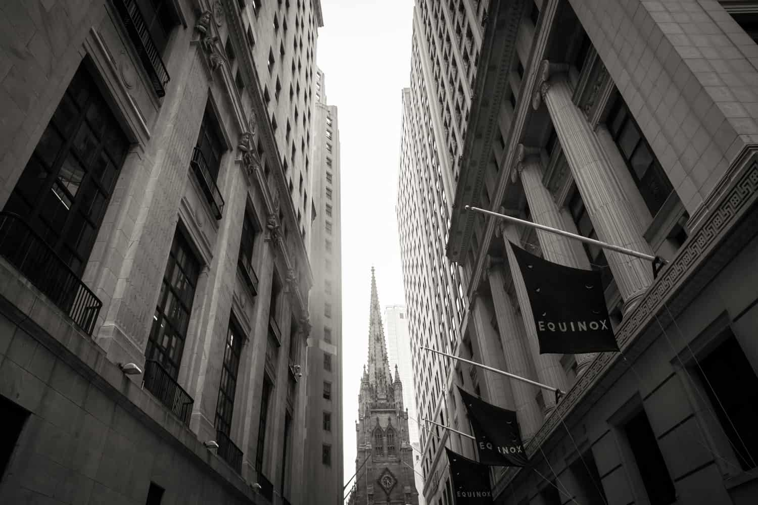 Black and white photo of Trinity Church through alleyway