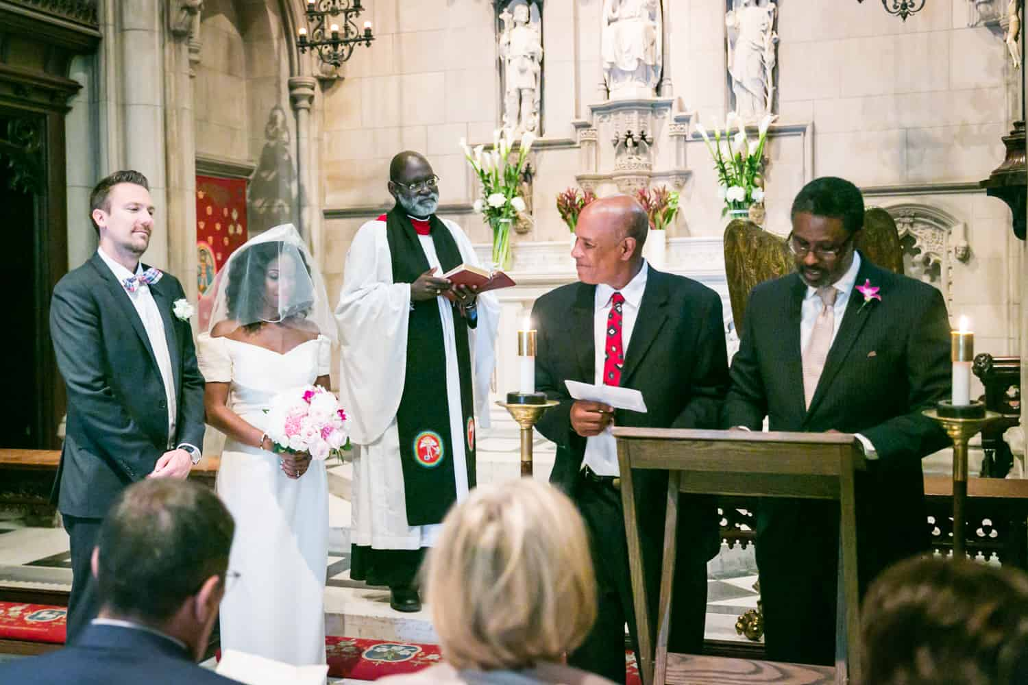 Bride and groom listening to speakers in a Trinity Church ceremony