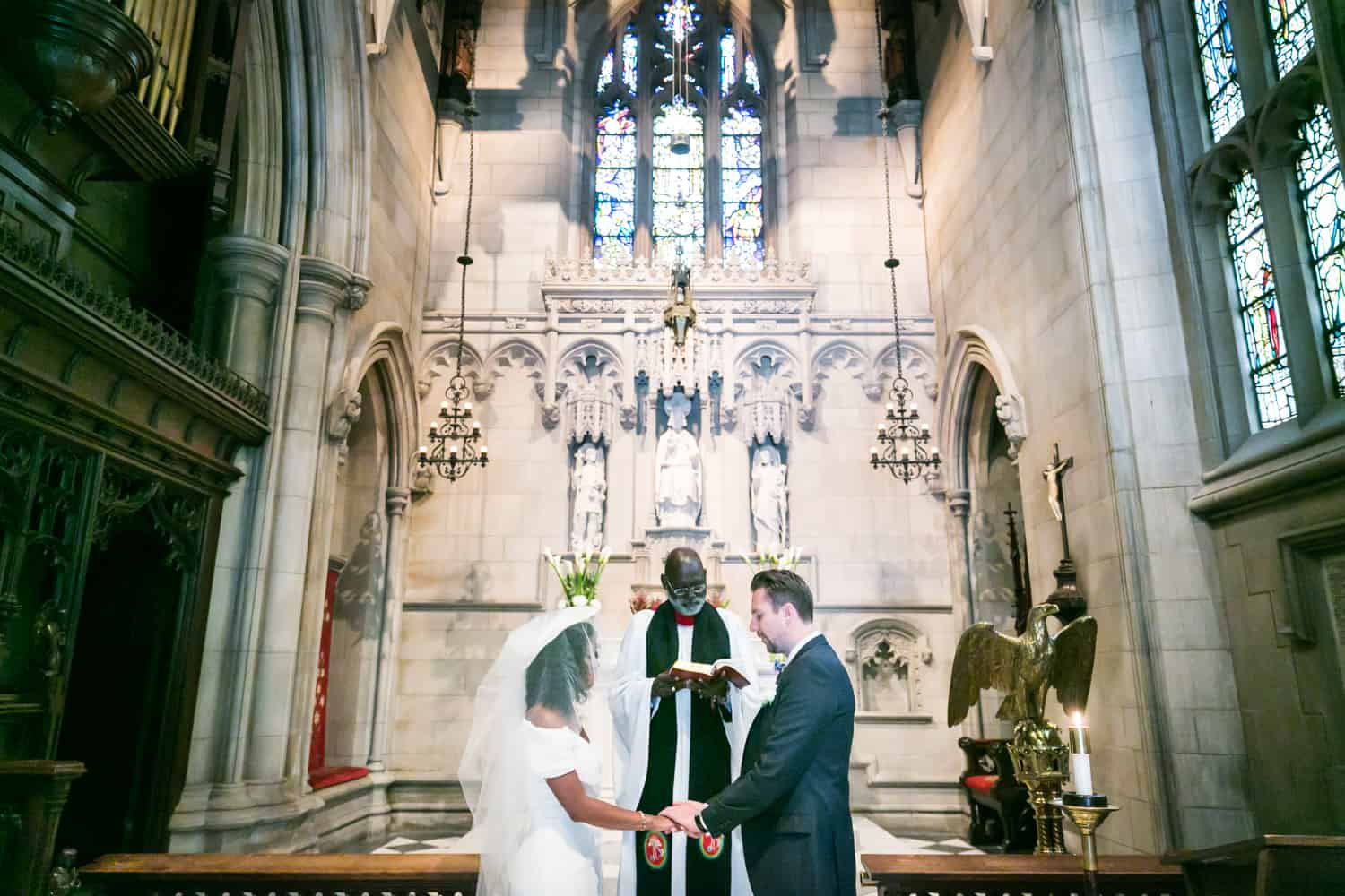 Bride and groom exchanging vows in a Trinity Church wedding
