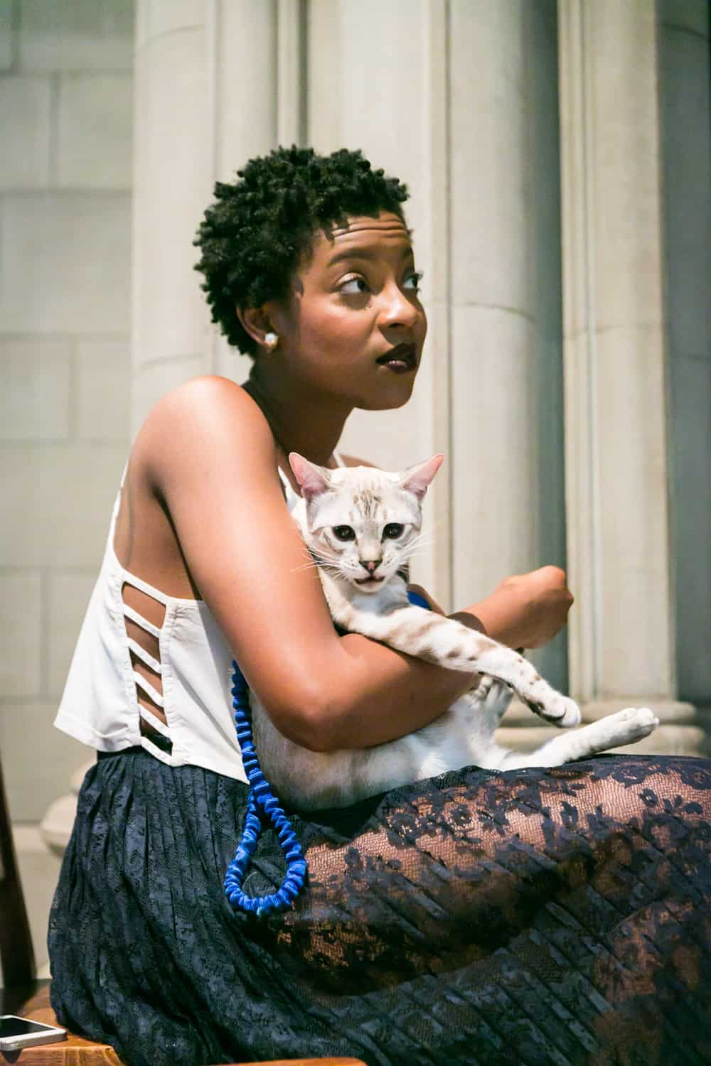 Maid of honor holding cat for an article on tips for including your pet in your wedding