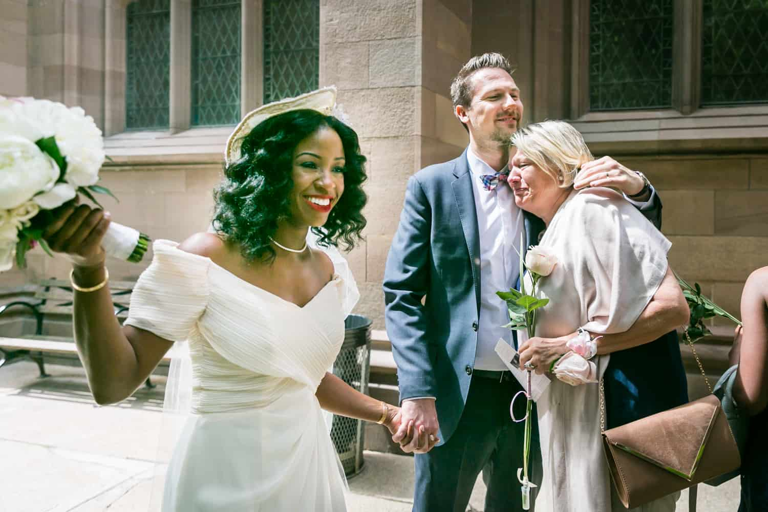 Bride, groom, and groom's mother after Trinity Church wedding ceremony