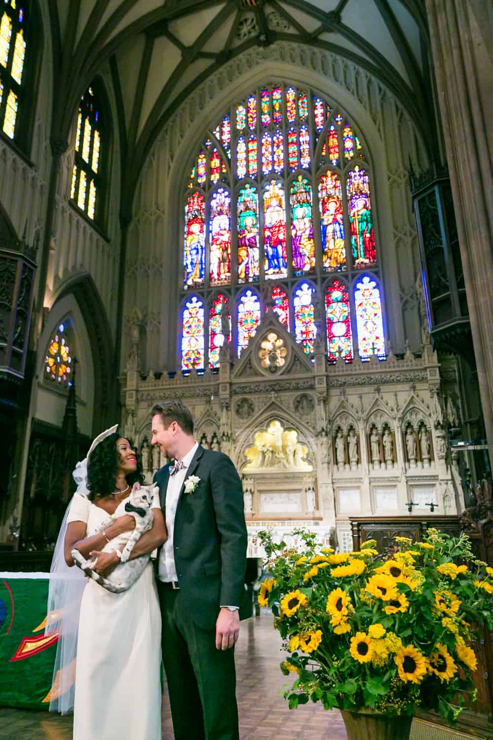 Bride and groom with cat in Trinity Church for an article on tips for including your pet in your wedding