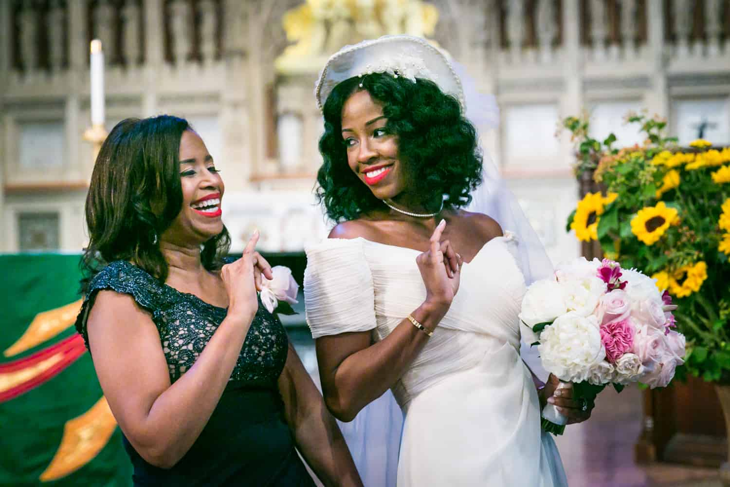 Bride dancing with mother in Trinity Church