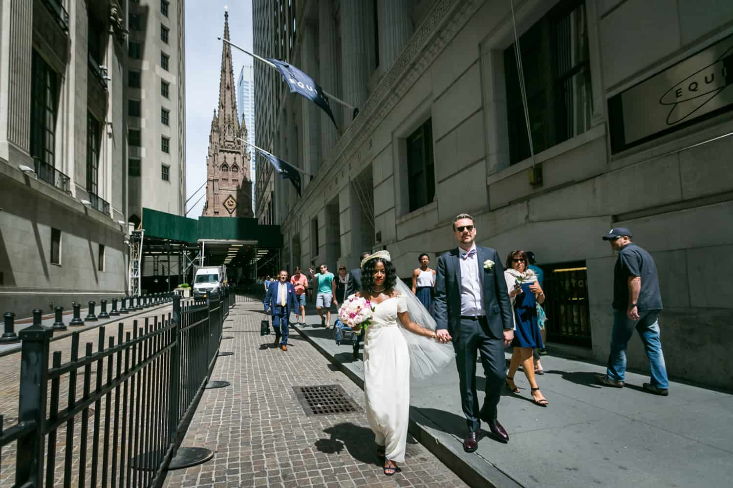 Bride, groom, and guests walking from Trinity Church