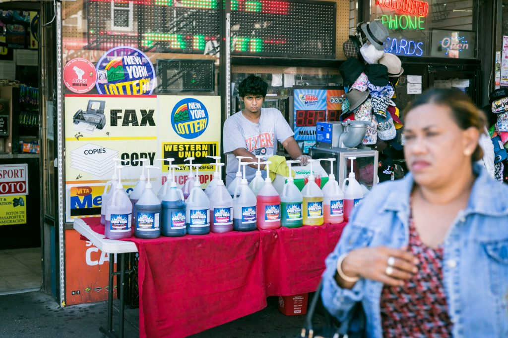 Young man selling shaved ice in Richmond Hills, Queens