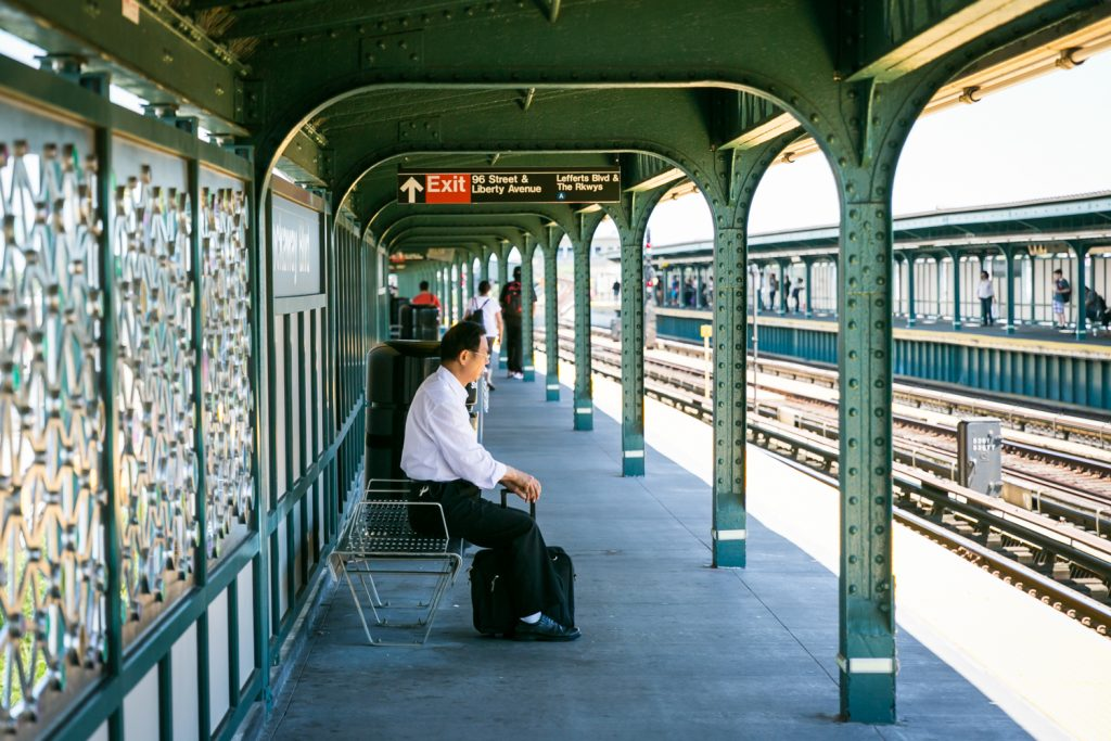 Man sitting on bench in subway platform
