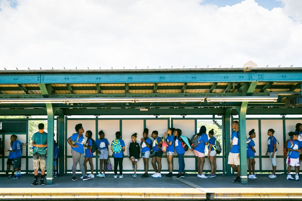 Line of young people waiting on a subway platform