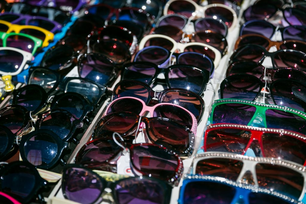 Sunglasses for sale lined up on a table